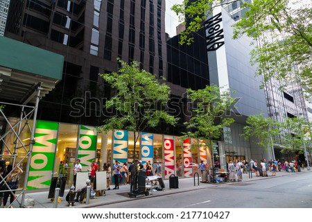 NEW YORK CITY, USA -  30TH AUGUST 2014: The outside of the Moma Museum in central New York. People can be seen outside - stock photo