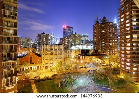 New York City view from between high rise apartment buildings in Chelsea towards midtown Manhattan skyscrapers. - stock photo