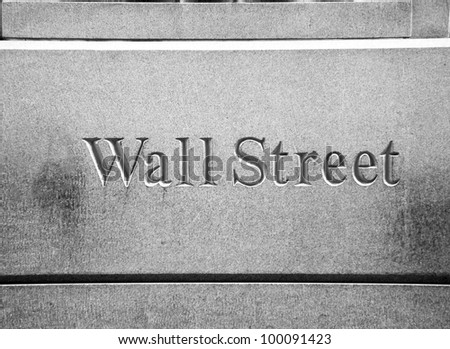 New York City Wall Street road sign in downtown Manhattan with skyscrapers - stock photo