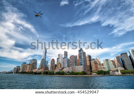 New York City with Manhattan skyline from Hudson River with a helicopter - stock photo