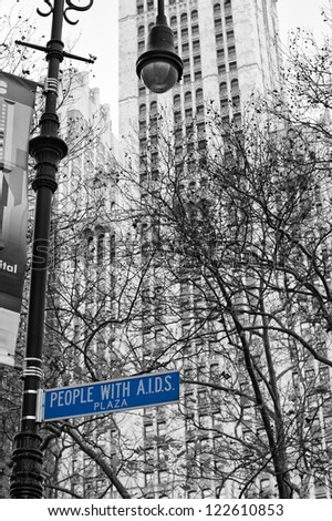 NEW YORK Dec,8 A view in black and white of people with aids plaza with blue sign - stock photo
