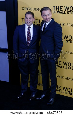 "NEW YORK-DEC 17: Actor Leonardo DiCaprio (R) and Jonah Hill attend the premiere of ""The Wolf of Wall Street"" at the Ziegfeld Theatre on December 17, 2013 in New York City.  - stock photo"