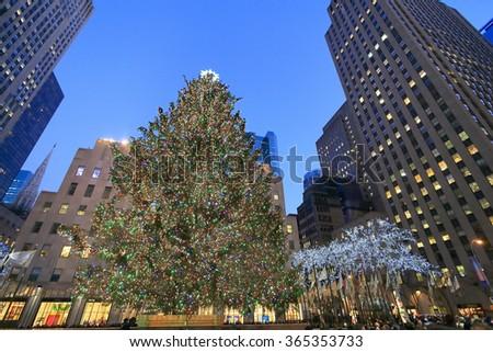 NEW YORK-DEC 26:  All decorated Christmas tree surrounding Rockefeller Center buildings on December 26, 2013. - stock photo