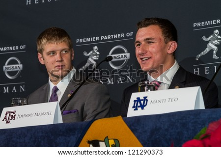 NEW YORK - DEC 8:  Heisman Trophy finalists Colin Klein (L) and Johnny Manziel (R) address the press at the 2012 Heisman Trophy press conference at Marriott Marquis in New York City on December 8, 2012. - stock photo