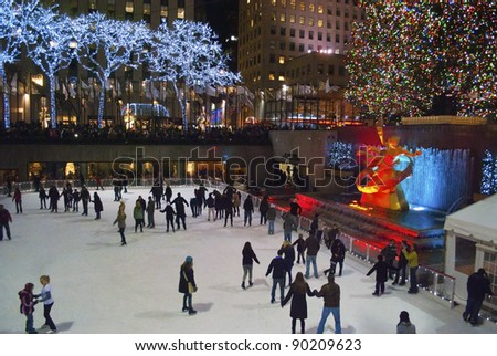 NEW YORK-DEC 2: Ice skaters and tourists are all around the famous Rockefeller Center Christmas tree on December 2, 2011. - stock photo