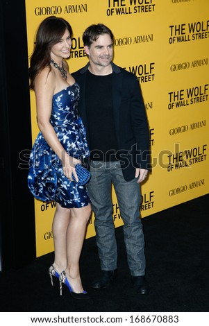 "NEW YORK-DEC 17: NASCAR driver Jeff Gordon and wife Ingrid Vandebosch attend the premiere of ""The Wolf of Wall Street"" at the Ziegfeld Theatre on December 17, 2013 in New York City.  - stock photo"