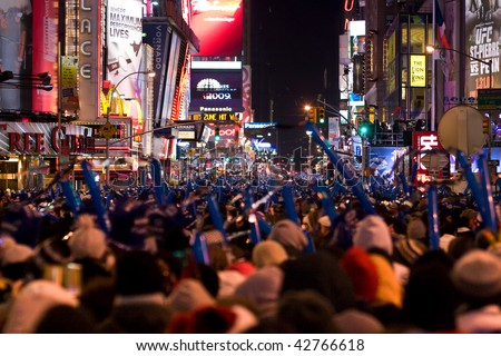 NEW YORK - DEC 31: Pedestrians gather in Times Square for New Year's Eve celebrations on December 31, 2008 in New York City. - stock photo