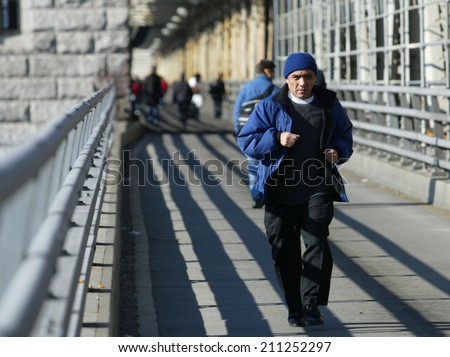 NEW YORK - DECEMBER 21:  A jogger runs over the Queensborough Bridge (59th Street Bridge) during the second day of the transit strike December 21, 2005 in New York City. - stock photo