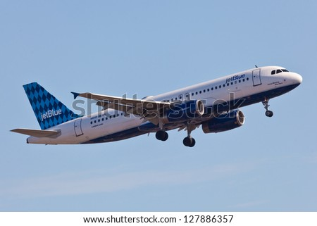 NEW YORK - DECEMBER 9: Airbus A320 JetBlue approaching JFK in New York, USA on December 9, 2012 The A320 was the first narrow body airliner from Airbus It is the biggest competition to Boeing 737NG - stock photo