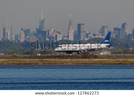 NEW YORK - DECEMBER 9: Airbus A320 JetBlue lining up on JFK in New York USA on December 9, 2012 The A320 was the first narrow body airliner from Airbus It is the biggest competition to Boeing 737NG - stock photo