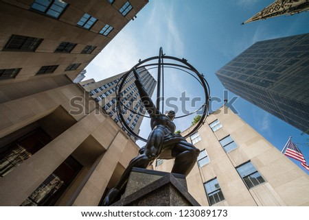 NEW YORK - DECEMBER 30: Atlas Statue on December 30, 2012 in New York. Atlas Statue is a bronze statue in front of Rockefeller Center in midtown Manhattan, New York City. - stock photo