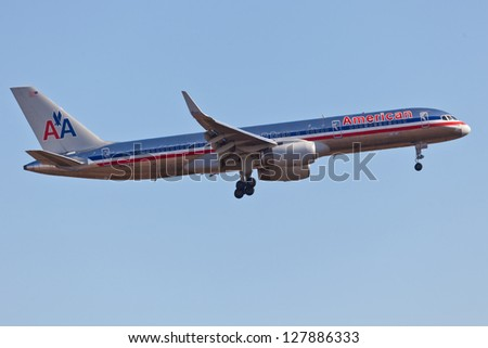NEW YORK - December 9: Boeing 757 American Airline approaches JFK in New York, USA on December 9, 2012. American Airline is on of the oldest American airlines and one of the biggest in the world - stock photo