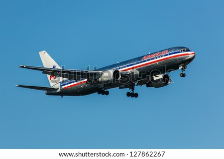 NEW YORK - DECEMBER 6: Boeing 767 American Airline approaching JFK Airport in New York USA on December 6, 2012. American Airline is one of the biggest and oldest airline in the world - stock photo