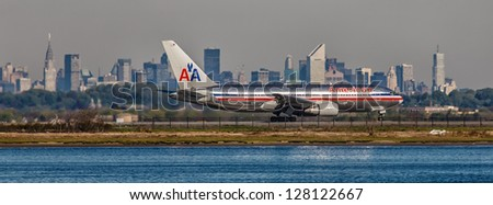NEW YORK - DECEMBER 9: Boeing 767 American Airlines lining up on JFK runway in New York USA on December 9 2012 The 767 flies across the Atlantic more frequently than all other jetliners combined - stock photo