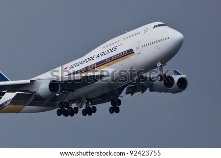 NEW YORK - DECEMBER 21:Boeing 747 Singapore Airlines approaches JFK in New York, USA on January 15, 2011 Airlines flies to destinations in 35 countries on six continents its primary hub is Singapore - stock photo