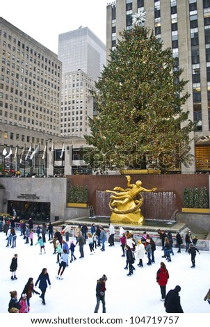 NEW YORK - DECEMBER 26: Ice skaters and tourists are all around the famous Rockefeller Center Christmas tree on December 26, 2011 in  New York City. - stock photo