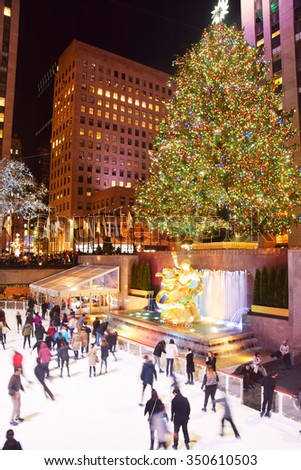 NEW YORK - DECEMBER 8, 2015: Locals and visitors skate under the Rockefeller Center Christmas tree in New York City on December 8, 2015 - stock photo