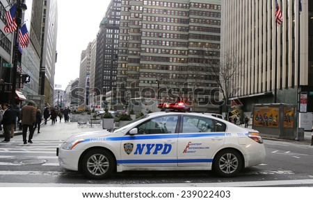 NEW YORK - DECEMBER 18 NYPD car providing security at Times Square area on December 18, 2014. New York Police Department, established in 1845, is the largest police force in USA - stock photo