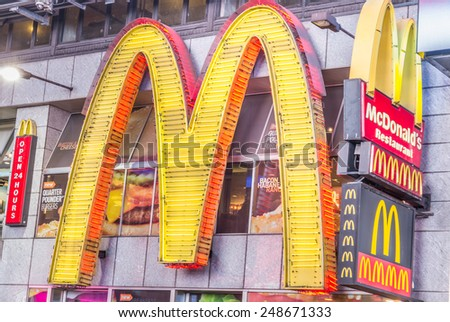 NEW YORK - DECEMBER 22, 2013: sign-logo of the chain Mc Donald's  in Times Square,New York. - stock photo