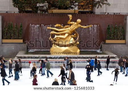 NEW YORK - DECEMBER 26:  Statue of Prometheus above the ice rink at the Rockefeller Center on December 26 2012 in Manhattan New York. It was created by American sculptor Paul Manship. - stock photo