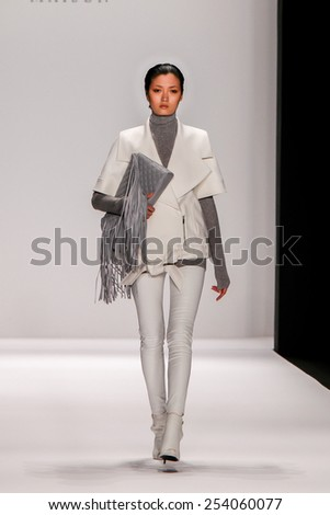NEW YORK - FEB. 18, 2015: A model walks the runway at the Thomas Wylde Maison fashion show during Mercedes-Benz Fashion Week at The Theatre at Lincoln Center on Feb. 18, 2015 in NYC. - stock photo