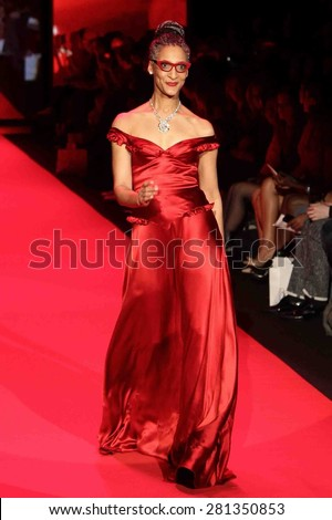 NEW YORK-FEB 12: Chef Carla Hall wears Evgenia at Go Red for Women-The Heart Truth Red Dress Collection at Mercedes-Benz Fashion Week at Lincoln Center on February 12, 2015 in New York City. - stock photo