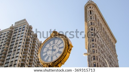 NEW YORK - FEB 12: Flat Iron building facade and clock on February, 2012. Completed in 1902, it is considered to be one of the first skyscrapers ever built - stock photo