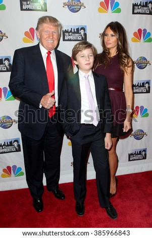 NEW YORK-FEB 16: (L-R) Donald Trump, son Barron  Trump and wife Melania Trump attend 'The Celebrity Apprentice' finale at Trump Tower on February 16, 2015 in New York City. - stock photo