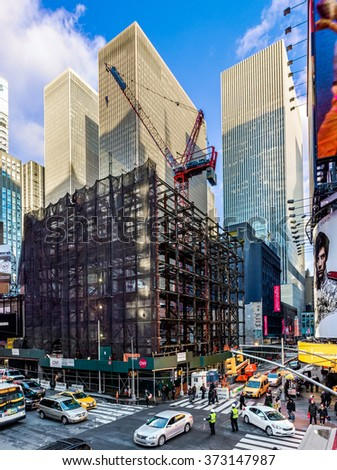 NEW YORK-FEBRUARY 5 - A large construction crane sits upon a work site on 47th St. in Times Square on February 5, 2016 in New York City. - stock photo