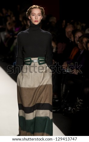 NEW YORK - FEBRUARY 11: A model is walking the runway at Carolina Herrera Collection for Fall/Winter 2013 during Mercedes-Benz Fashion Week on February 11, 2013 in New York - stock photo
