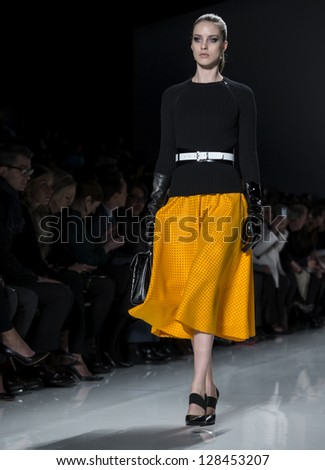 NEW YORK - FEBRUARY 13: A model is walking the runway at Michael Kors Collection for Fall/Winter 2013 during Mercedes-Benz Fashion Week on February 13, 2013 in New York - stock photo