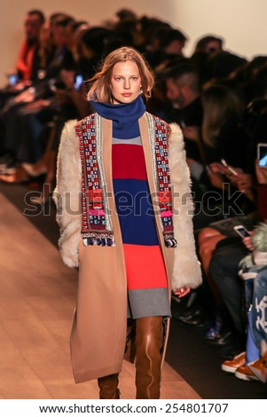 NEW YORK - FEBRUARY 12: A model walks the runway at the BCBGMAXAZRIA Fall/Winter 2015 collection during Mercedes-Benz Fashion Week in New York on February 12, 2015. - stock photo