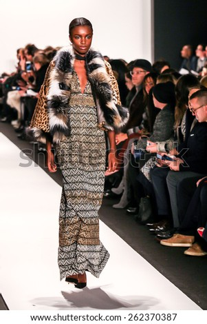 NEW YORK - FEBRUARY 16: A model walks the runway at the Dennis Basso Fall/Winter 2015 collection during Mercedes-Benz Fashion Week in New York on February 16, 2015. - stock photo