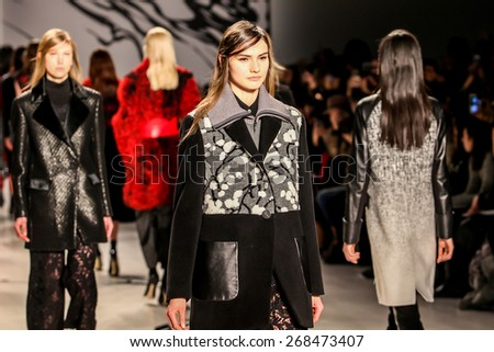 NEW YORK - FEBRUARY 16: A model walks the runway at the Lie Sangbong  Fall/Winter 2015 collection during Mercedes-Benz Fashion Week in New York on February 16, 2015. - stock photo