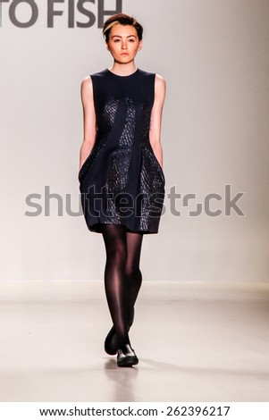 NEW YORK - FEBRUARY 16: A model walks the runway at the Ready to Fish Fall/Winter 2015 collection during Mercedes-Benz Fashion Week in New York on February 16, 2015. - stock photo