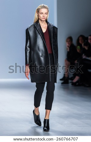NEW YORK - FEBRUARY 16: A model walks the runway at the Taoray Wang Fall/Winter 2015 collection during Mercedes-Benz Fashion Week in New York on February 16, 2015. - stock photo