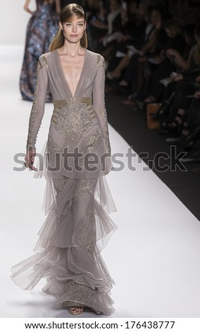 NEW YORK - FEBRUARY 11 2014: A model walks the runway during Badgley Mischka Fall 2014 fashion show at New York Mercedes - Benz Fashion Week - stock photo