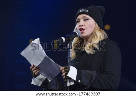 NEW YORK - February 5, 2014: Madonna speaks during the Bringing Human Rights Home concert on February 5, 2014 in Brooklyn, New York.  - stock photo