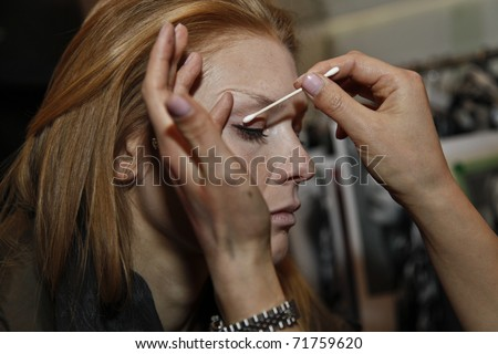 NEW YORK - FEBRUARY 15: Model prepares backstage for presentation at the Concept Korea Fall 2011 at Mercedes-Benz Fashion Week in David Rubenstein Atrium on February 15, 2011 in New York City - stock photo