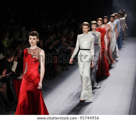 NEW YORK - FEBRUARY 13: Models walk runway for Jenny Packham collection during Fashion week at Lincoln Center in Manhattan on Feb 13, 2012 in New York City - stock photo