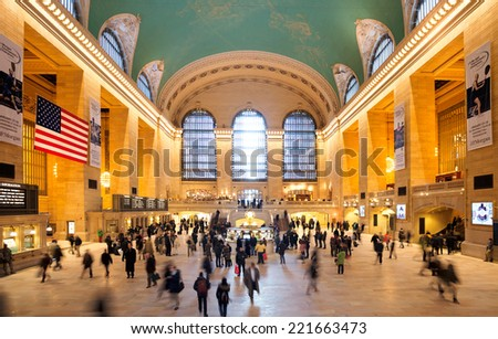New York, Jan 22: Commuters and tourists in the grand central station in Jan 22, 2014 in New York. It is the largest train station in the world. - stock photo