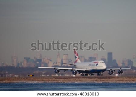 "NEW YORK - JANUARY 6: A Boeing 747-400 passengers plane  British Airways ""Speedbird"" departs from JFK Airport Runway 4L on January 6, 2010 in New York - stock photo"
