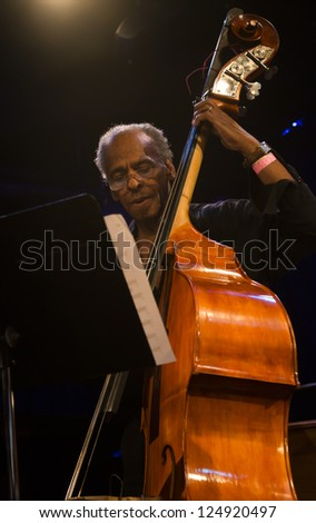 NEW YORK - JANUARY 12: Cecil McBee bass performs with Billy Harper band The Cookers on stage as part of NYC Winter Jazz Festival at Le Poisson Rouge on January 12, 2013 in New York City - stock photo