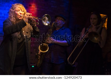 NEW YORK - JANUARY 12: Pam Fleming trumpet, Steve Elson sax & Reut Regev trombone perform with Hazmat Modine band on stage of NYC Winter Jazz Festival at The Bitter End on January 12, 2013 in New York - stock photo