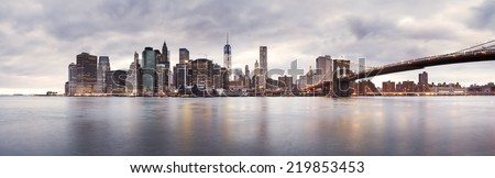 New York, 19 January 2014 - The Brooklyn Bridge and Lower Manhattan skyline - stock photo