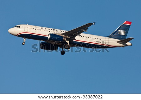 NEW YORK - JANUARY 21: US Airways A320 on short final to JFK airport located in New York on January 21, 2012. US Airways operates 3,310 flights a day to 200 destinations in 30 countries - stock photo