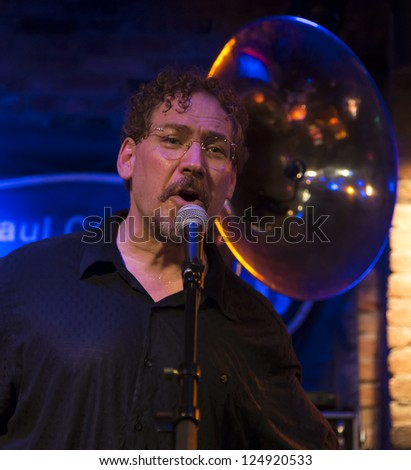 NEW YORK - JANUARY 12: Wade Schuman vocals performs with Hazmat Modine band on stage as part of NYC Winter Jazz Festival at The Bitter End on January 12, 2013 in New York City - stock photo