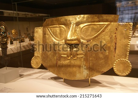 NEW YORK - JUL 24, 2008 - Inca Funerary mask of hammered gold from Peru    - stock photo