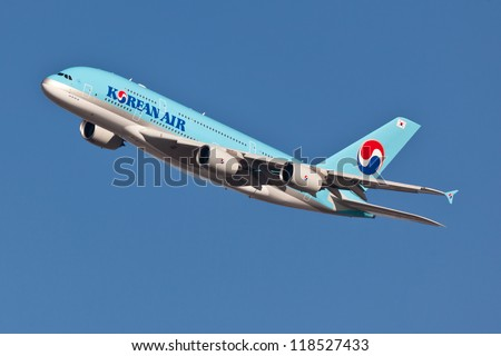 NEW YORK - JULY 7:A380 Korean Air climbs after take off from JFK airport located in New York on July 7,2012. Blue top livery was introduced on in 1984. A380 is the biggest passenger plane in the world - stock photo