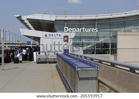 NEW YORK- JULY 10: Delta Airline Terminal 4 at John F Kennedy International Airport in New York on July 10, 2014. JFK is one of the biggest  airports in the world with 4 runways and 8 terminals  - stock photo